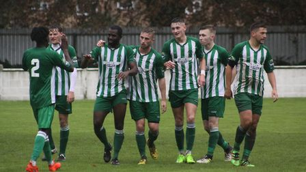 Soham Town Rangers celebrate Gary Cohen finding the net in their 2-2 draw with Canvey Island. Photo:
