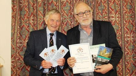 Mike Petty (left) presents awards to local councillor and author Mike Rouse