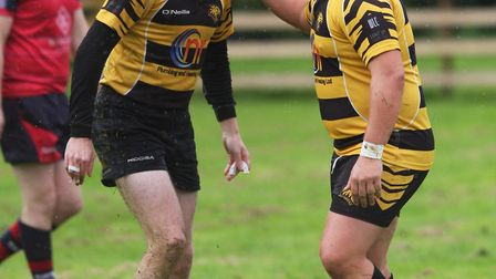 Joel Scott Paul and Nathan Brooks celebrate Ely Tigers' opening try in their 25-7 win over Wisbech.