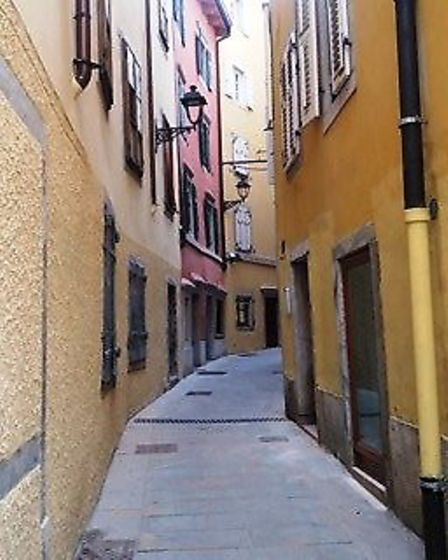 A hidden street scene away from the busy shopping centres of the port of Trieste - part of the Ital