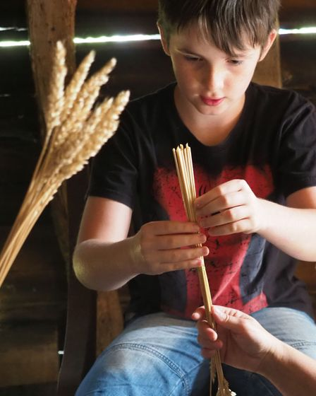 Young-visitor-making-a-Corn-Do