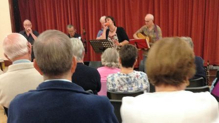 Hobson's Voice entertaining the society members