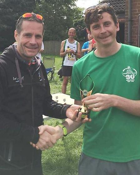Martin Jennings being presented with his third place award.