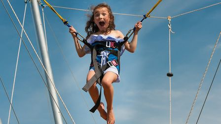 A young girl enjoys the bungee seat. Picture: SAFFRON PHOTO
