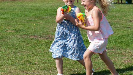 Two youngsters play with water pistols. Picture: SAFFRON PHOTO