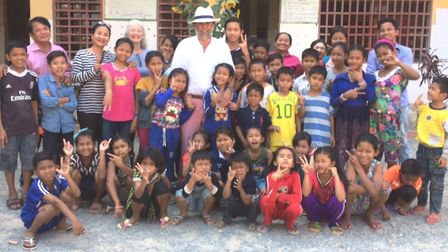 Peter Harris with some of the children at the Centre for Childrens Happiness in Phnom Penh which he
