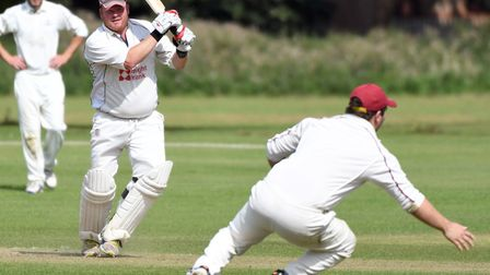 Gary Freear in action during Wisbech's 84-run victory over March Town. Photo: IAN CARTER