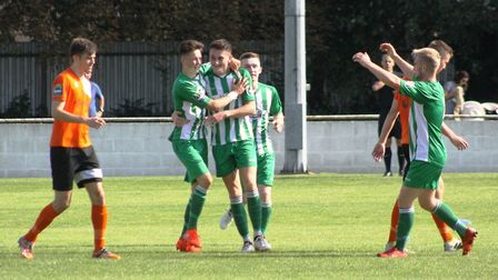 Soham celebrate Matty Allan's (left) goal in their 2-2 draw with Bury Town. Photo: ANDY BURFORD
