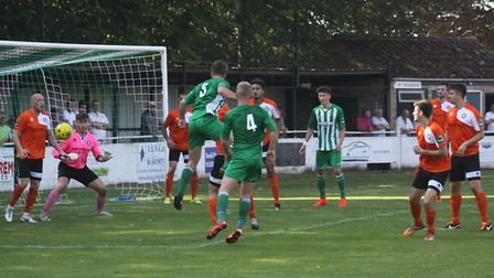 Action from Soham's 2-2 draw with Bury Town on Monday. Photo: ANDY BURFORD