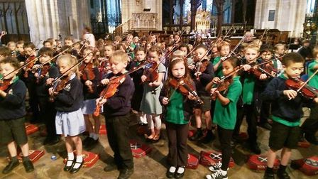 Cambridgeshire Arts in Ely Cathedral. Ely St Mary's Year 3 strings project.
