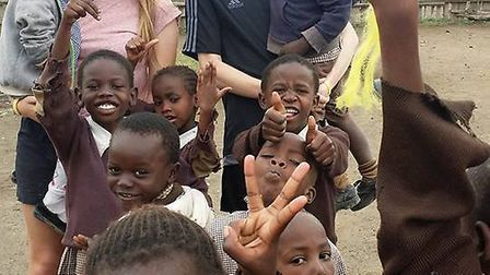 Ely College students with some of the school children they helped in Kenya