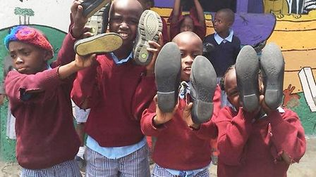 Some of the Kenyan school children pictured with their new shoes which were donated by Ely College s
