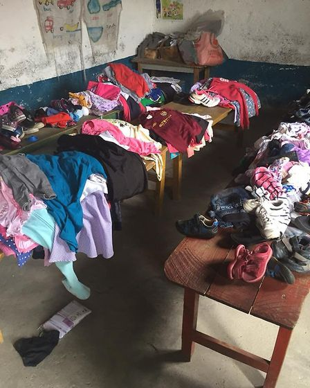 Some of the shoes and clothes that were donated by Ely people for Ely College students to take over