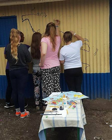 Ely College students drawing at one of the school's they helped in Kenya as part of the African Adve