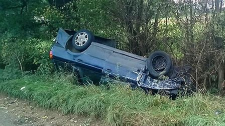 Vehicle left upside down in a ditch at Langwood Hill Drove. Police took both drivers home to safety.