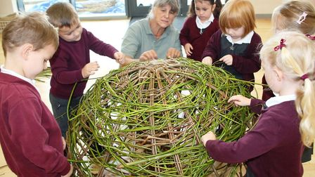 Isle of Ely School pupils working with Jane Frost to create a woven willow apple to grace this year'