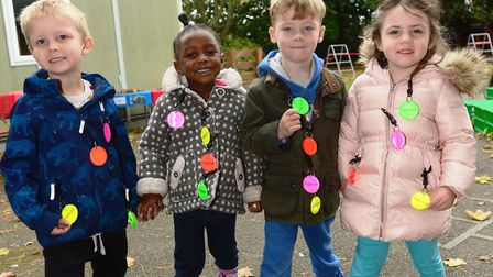 Pupils at Park Lane Primary School show off their hi-visibility bag tags, donated by developer David
