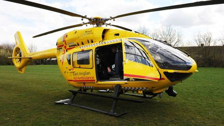 East Anglian Air Ambulance Trust helicopter lands All Saints field.