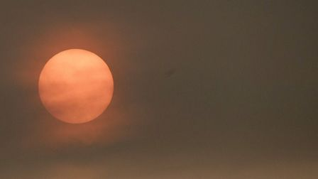 The sun glowed red in March on Monday. BBC weather presenter Simon King said it was due to the remna