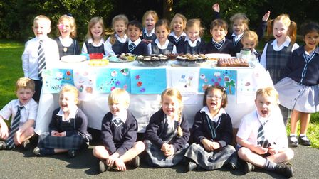 Children at King's Ely Acremont and Nursery held a charity cake sale and raised £400 for victims of