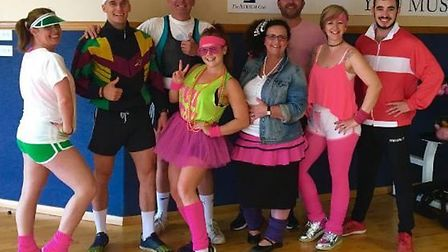 Staff at Atrium Fitness in Ely dressed up in neon tutus and 80s sportswear as part of National Activ