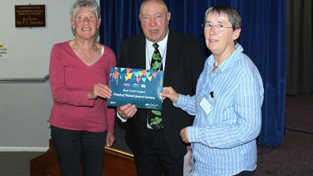 Sue Beel (left) and Sarah Ledger (right), from Friends of Wisbech General Cemetery, collect award fo