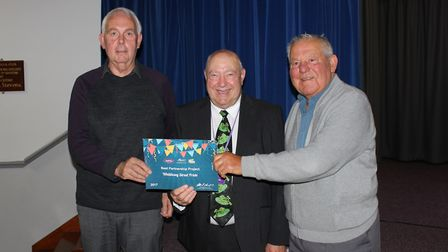 Alan Hobbs (left) and Fred Mills (right), from Whittlesey Street Pride, receive award for Best Partn
