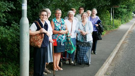 Residents of Edina Court residential home waiting for a bus trip to Wisbech Tesco Extra in Cromwell