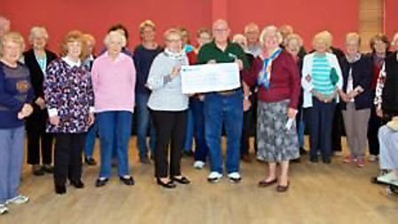 Sutton Garden Club members attend the cheque presentation by club treasurer Maureen Rose and show se