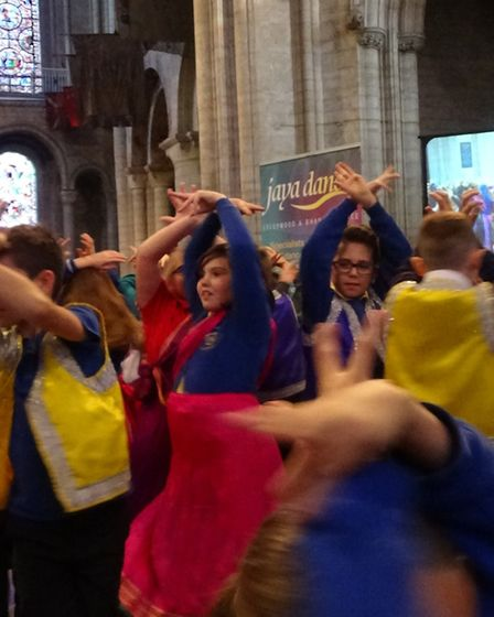 Jaylynn Cousins and Harry Mason doing a traditional Indian dance at Ely Cathedra