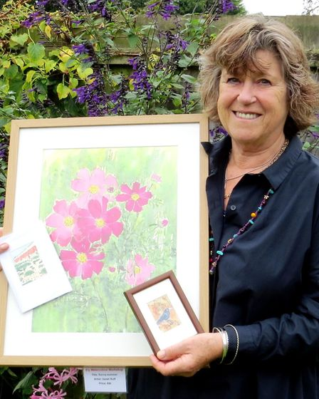 Sarah Ruff, chairman of Ely Watercolour Workshop, with some of the artwork that will be on sale at t