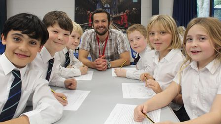 King's Ely Junior students with award-winning children's author Mark Lowery.