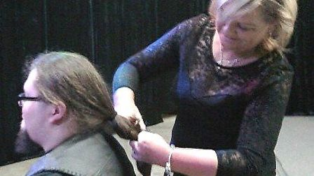 March man Adrian raises £600 for Little Princess Trust by losing 12 inch ponytail for charity. He br