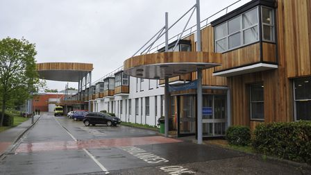 Hinchingbrooke Hospital says it is addressing staffing issues after a man died following a routine
