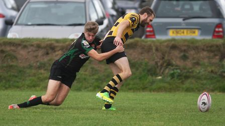 Joel Scott-Paul gets tackled off the ball to win a penalty try. Photo: Steve Wells