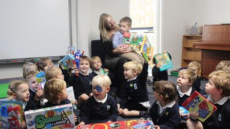 Samantha and Jackson Hill collect the donated toys and books from children at King's Ely Acremont an