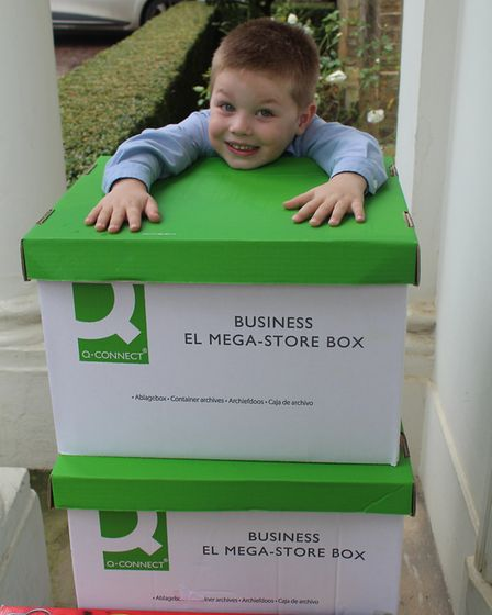 Jackson Hill pictured with some of the boxes of donated toys and books.