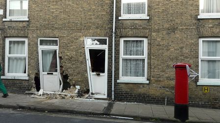 This was the scene after a car crashed into a house on Waterside, Ely, at around 10.45pm on Tuesday