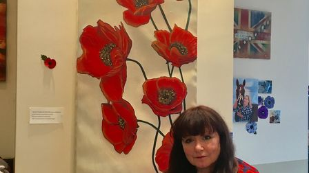 Michelle Deyna Hayward at Paninis in March. She is selling poppy paintings to help raie funds for th