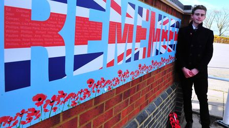 Edward Ouzman with his War Memorial - Wichford Village College Remembrance Service. PHOTO: Harry Rut