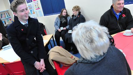 Edward Ouzman interacting with villagers at Wichford Village College Remembrance Service. PHOTO: Har