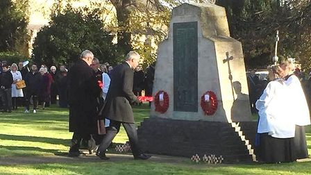 Littleport Parish Council chairman Clive Webber and MP Steve Barclay laying a wreath in Littleport.