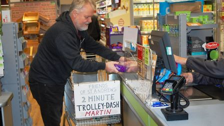 A 'trolley-dash' took place in the Whittlesey Coop to raise money for St Andrew's Church maintenance