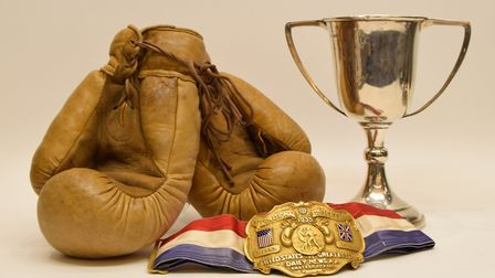 The golden gloves, cup and belt from Floyds 1935 New York victory, part of the archive for sale at S
