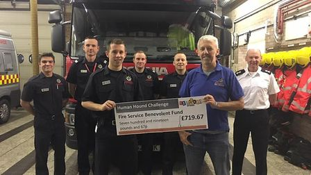 Whittlesey firefighter, Aaron Dunmore has been presented with over £700 for The Fire Fighters Charit