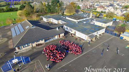Children from Park Lane, Whittlesey, create a giant poppy for Armistice Day PHOTO: Adam Pallister