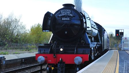 The Flying Scotsman shoots through March rail station. PHOTO: Harry Rutter