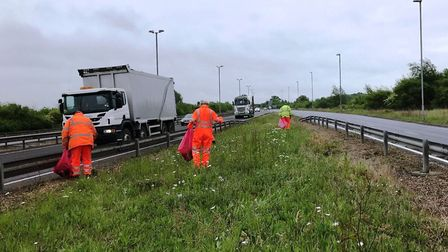 Uttlesford District Council workers clearing rubbish from along the A120. Picture: UDC