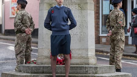 Air Cadet Emily Clark (front) at the war memorial with Army Cadets either side. Picture: SAFFRON PHO