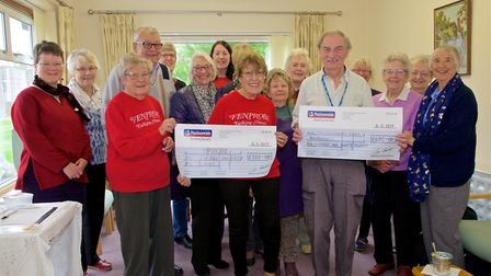 The Nellie?s Community Café team presented a cheque for £550 to Fenprobe, the talking newspaper for